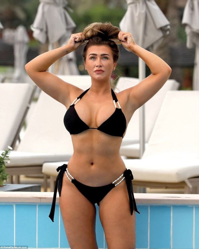 Full-on glamour: She pulled her brunette hair up into a loose bun as she waded into the water, keen not to let her dip in the pool ruin her glamorous look