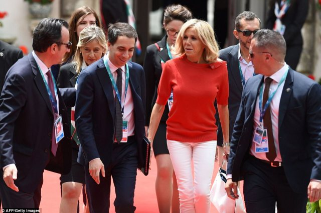 France's First Lady Brigitte Macron opted for the dressed down look in white skinny jeans and a simple red jumper