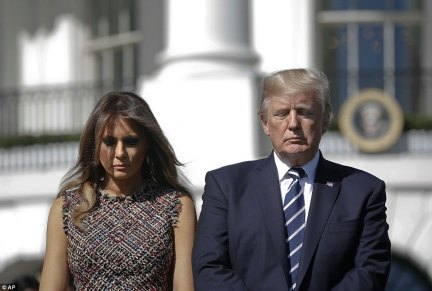 Donald Trump is seen here holding a moment of silence for the slain people on the South Lawn of the White House. He denounced the violence as 'evil' and offered his 'warmest condolences' to the families of the victims