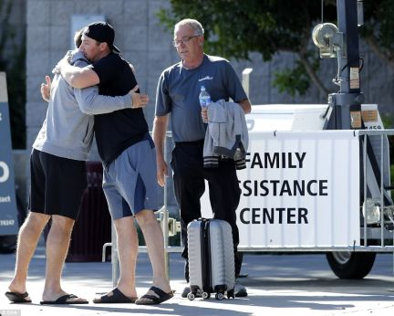 Family members of those injured or killed in the mass shooting tearfully gather at the Family Assistance Center in Las Vegas on Tuesday