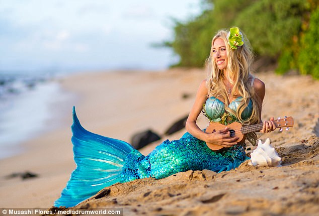 Hawaii woman overcomes self esteem by becoming mermaid   Daily Mail     Magical mermaid  Kari Roberts always wanted to be a mermaid and she made  her dream