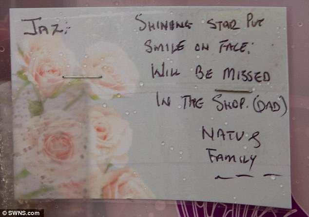 Cards, like the one seen above, and flowers were left in tribute near the youngster's home