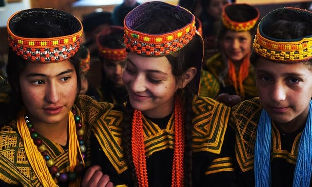 Kalash students attend a class at a school in the Brun village of Bumboret valley. ─ AFP