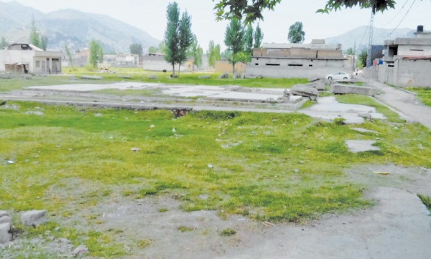 The site in Abbottabad's Bilal Town where once stood a huge compound which was raided by the US Navy Seals in the midnight of May 1 and May 2, 2011. The Americans claimed killing Al Qaeda chief Osama Bin Laden in the strike. Pakistani authorities later dismantled the building to prevent frequent visits by Osama's followers. The site now remains deserted most of the time.—Photo by writer