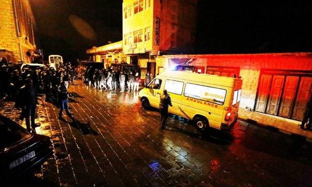 Jordanian policemen and an ambulance are seen in the vicinity of Karak Castle.—Reuters