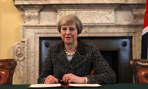 Britain's Prime Minister Theresa May, signs the official letter to European Council President Donald Tusk, invoking Article 50 and signalling the United Kingdom's intention to leave the EU, in the cabinet office inside 10 Downing Street.─AFP