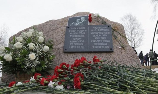 Flowers are placed by a memorial stone during a remembrance ceremony at the site of the 2010 plane crash that killed former Polish President Lech Kaczynski and 95 others.—Reuters/File