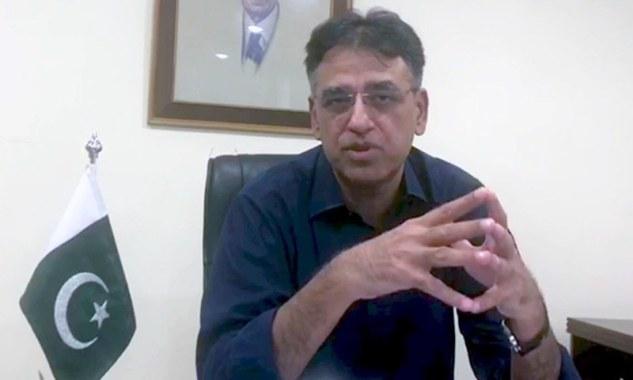 Finance Minister Asad Umar speaks in a video message. — DawnNewsTV