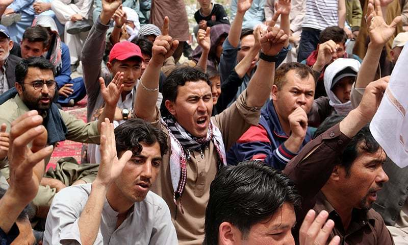 Family members and relatives chant slogans during a protest on April 13 to condemn the Hazarganji blast. ─ Reuters