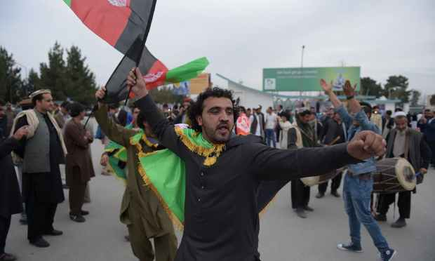An Afghan cricket fan dances in celebration. — AFP