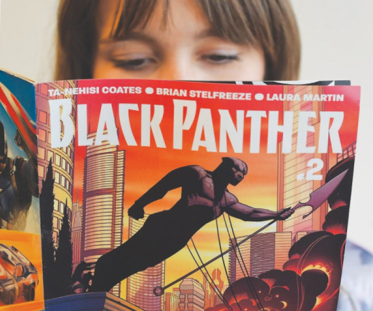 A WOMAN reads a copy of the comic book, Black Panther, published by Marvel Comics in New York.—AFP