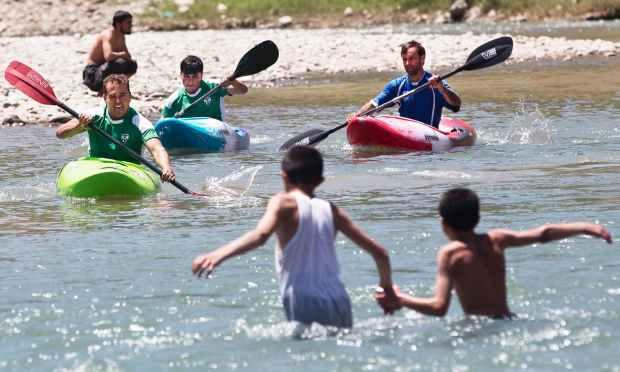 Afghan trainees practice kayaking along the Panjshir River.—AP