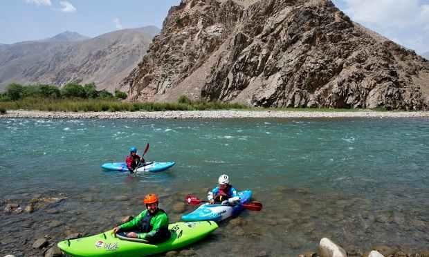 Three foreign tourists kayak along the Panjshir River.—AP