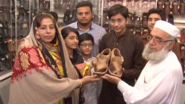 Jehangir Khan with his family holding the deer skin Peshawari chappals. - Photos by author