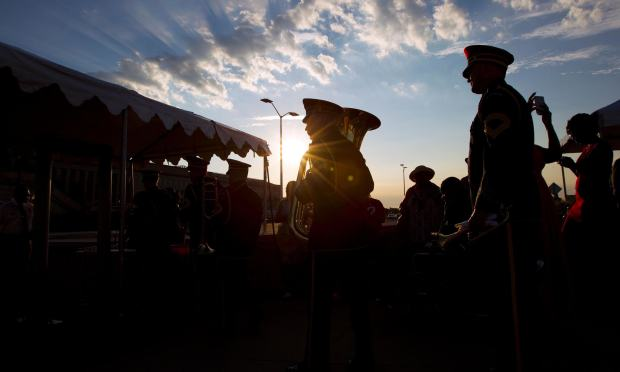 Members of the US Army Band arrive before the ceremony in observance to mark the15th anniversary of the 9/11 attacks at the Pentagon Memorial in Washington DC.  — AFP