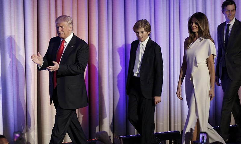 US President-elect Donald Trump greets supporters along with his wife and family during his election night rally. ─ Reuters