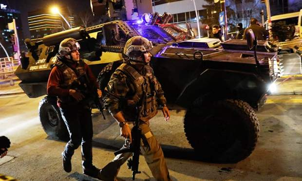 Turkish police secure the area near an art gallery where the Russian Ambassador to Turkey Andrei Karlov was shot dead. -Reuters