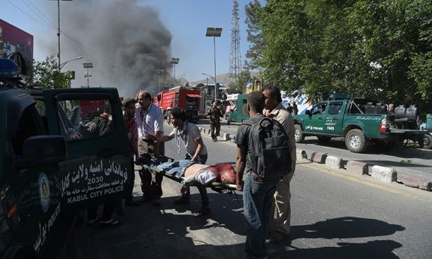 A victim is carried away on a stretcher at the site of the bombing.— AFP