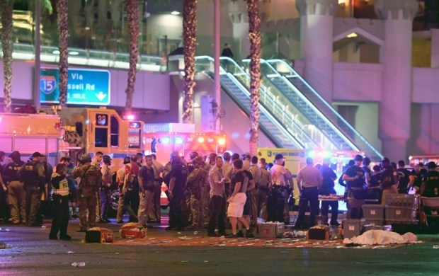 Police and rescue personnel gather at the intersection of Las Vegas Boulevard and Tropicana Ave after a shooting at a country music festival in Las Vegas, on October 2, 2017.—AFP