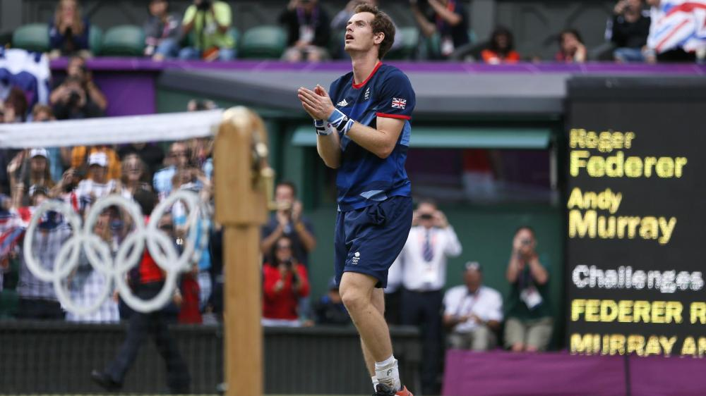 Britain's Andy Murray reacts after defeating Rogher Federer in the Olympic men's singles final