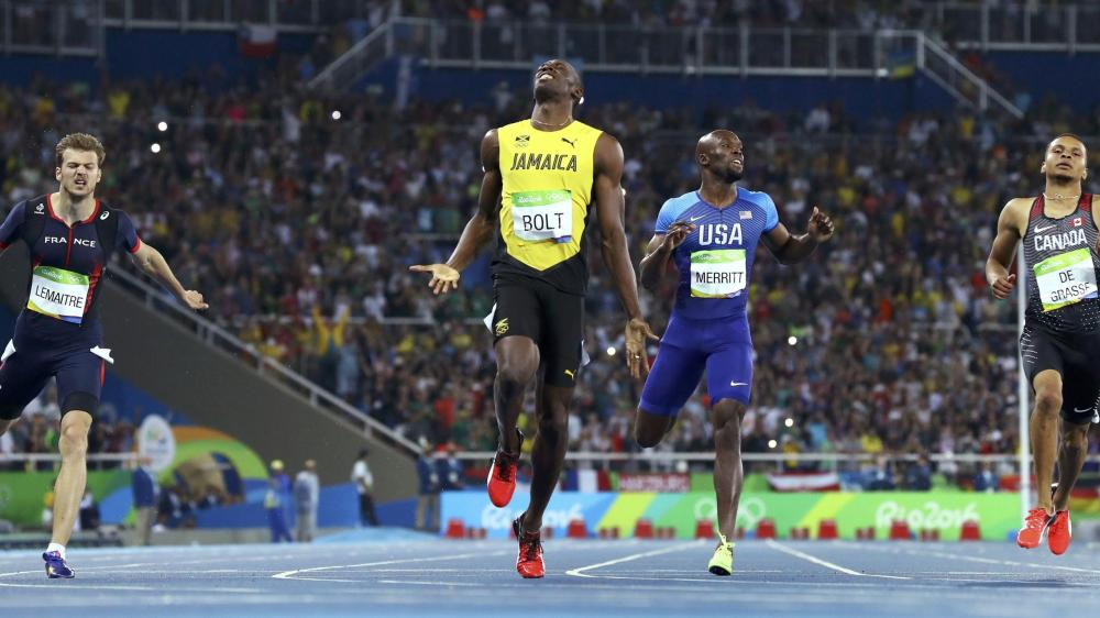 Usain Bolt (JAM) of Jamaica reacts as he finishes