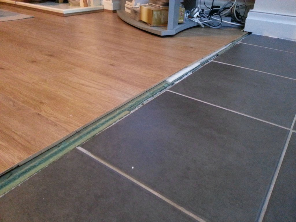 how can i transition between these floors kitchen laminate flooring enter image description here
