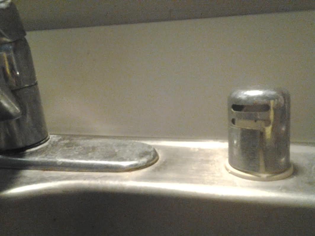 what can i do about my kitchen sink that has clogged suddenly and completely clogged kitchen sink enter image description here