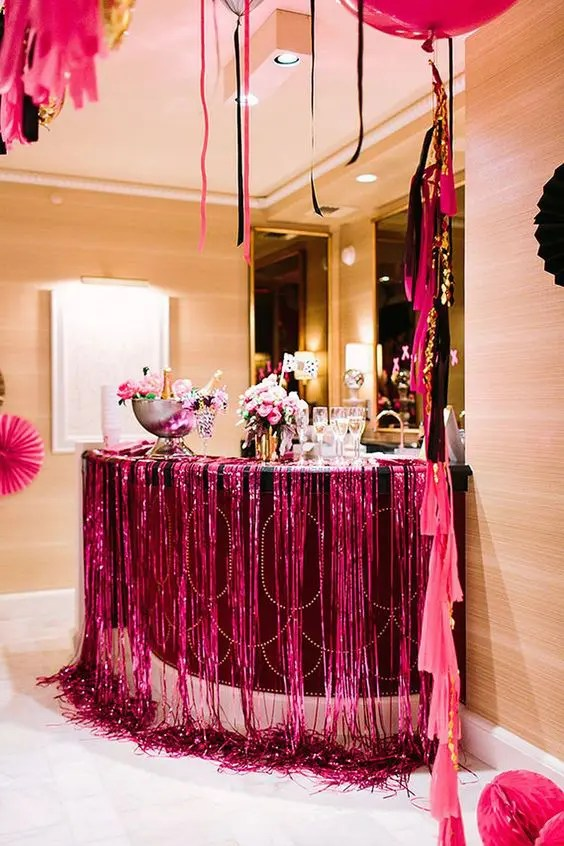 super colorful drink station for a bold bachelorette party in hot pink