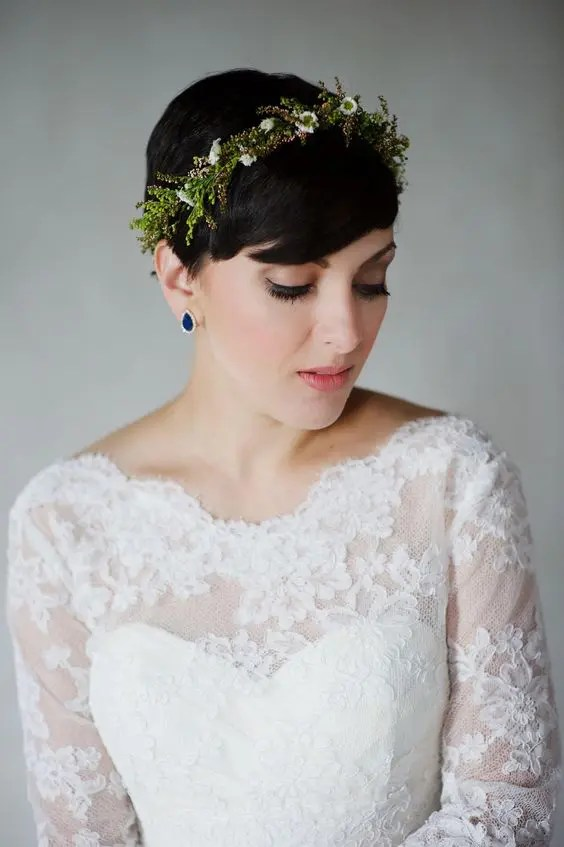 26 short wedding hairstyles and ways to accessorize them crazyforus a pixie hairstyle with a fresh floral and greenery headband plus sapphire earrings for a statement winobraniefo Image collections
