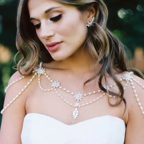 ivory pearls and rhinestones make the neckline look very interesting