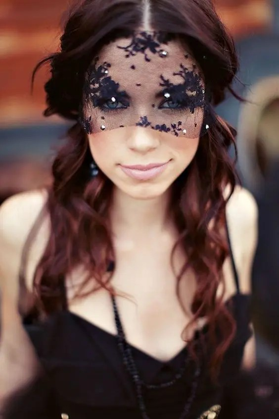 a small black lace veil with beads for a Halloween or dark romance bride