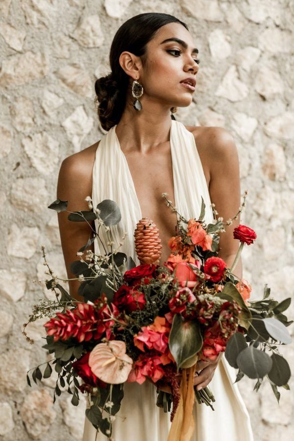 a tropical bride rocking statement copper and black geode earrings for a chic touch
