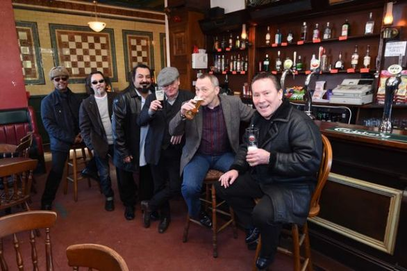 UB40 stars Earl Falconer, Jimmy Brown, Norman Hassan, Brian Travers and brothers Duncan and Robin Campbell at the Eagle and Tun pub in Digbeth
