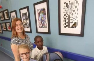Castle Hill's art work on show: Katrina Whale Enrichment activities facilitator, Summer Stephenson, Amadi Matala, Aliza Holroyd and Hariz Khurum.