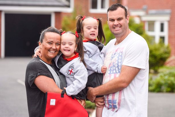 Identical twins born with Down's syndrome Abigail and Isobel when they were newborns, with their parents Matt and Jodi Parry