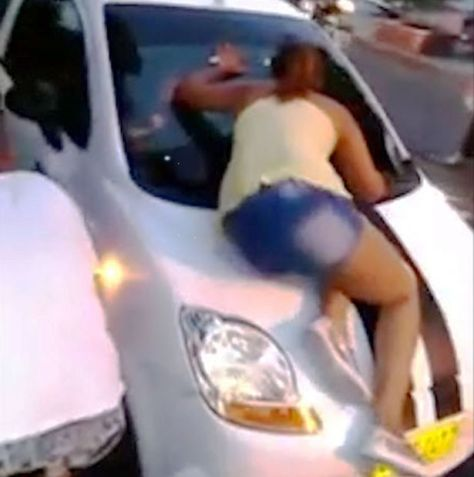 Woman busts husband with another woman, confronts him in traffic, smashes through windscreen of car