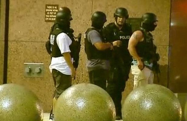 Armed officers were seen standing outside of a building in downtown Dallas