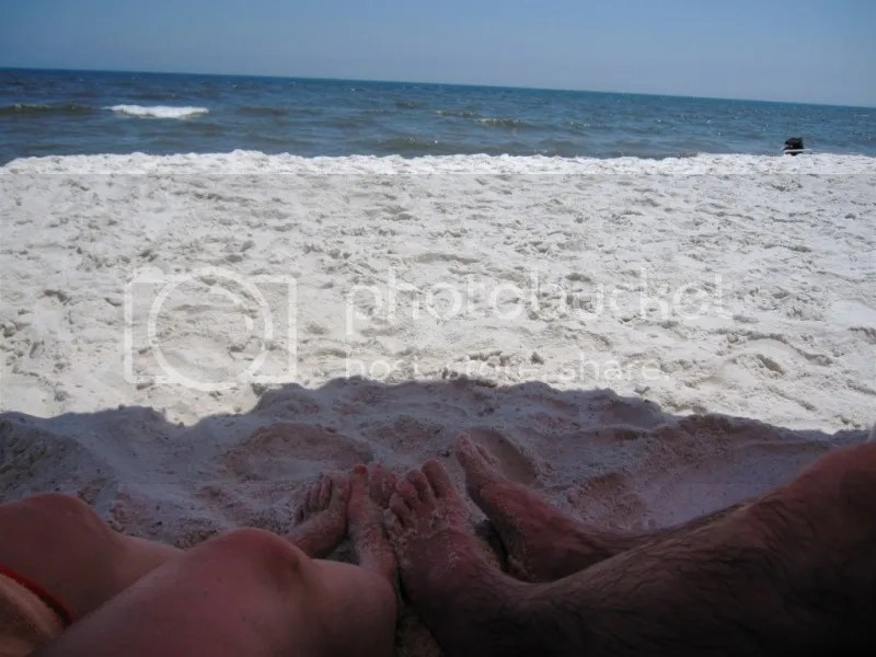 Tate and Dani's feet in the sand