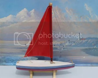 Toy Sailboat in front of a painting