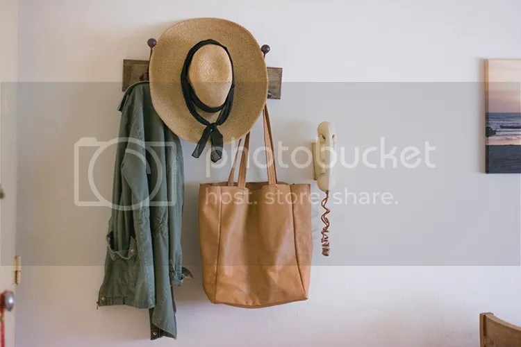 Straw hat on coat hanger