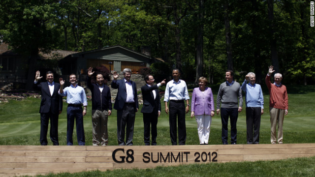 The 10 members of the G8 Summit pose for a group portait at Camp David, Maryland. Left to right: European Commission President Jose Manuel Barroso, Russian Prime Minister Dmitry Medvedev, Japanese PM Yoshihiko Noda, Canadian PM Stephen Harper, French President Francois Hollande, U.S. President Barack Obama, German Chancellor Angela Merkel, British PM David Cameron, Italian PM Mario Monti and European Council President Herman Van Rompuy.