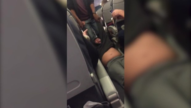 Man dragged off overbooked United flight