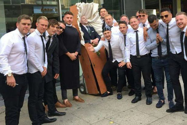 This is the hilarious moment a stag do dressed up the groom-to-be as a corpse and wheeled him around in a COFFIN - with his friends acting as mourners