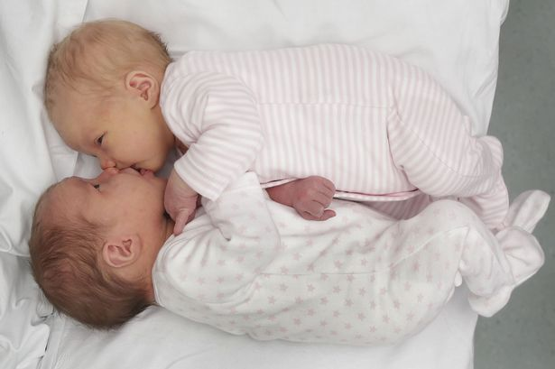 Newborn twins Rowan Rodger (top) and Isla Rodger (bottom), who defied the odds by becoming the third set for twins to be born by the same mother