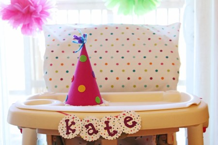 DIY high chair cover, first birthday party, colorful birthday party, tissue poms