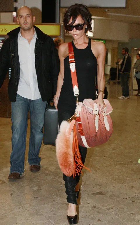 Victoria Beckham photo with Louis Vuitton messenger bag spring summer 2010