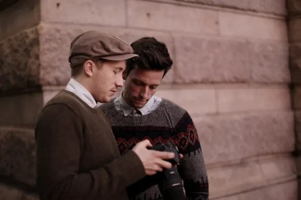 Fabian and Christian looking at their camera