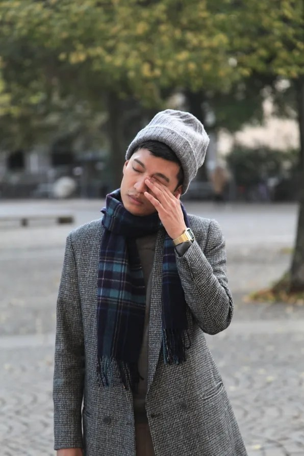 A very tired Bryanboy rubbing his eyes.