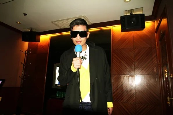 Bryanboy singing a song at karaoke in Shanghai