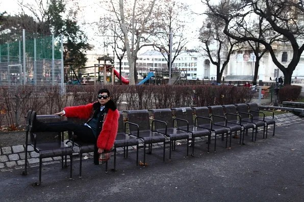 Bryanboy sitting on chairs at the park, Vienna